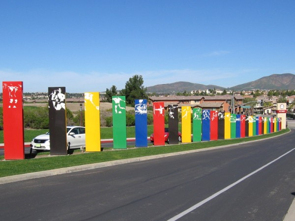 The colorful driveway into the 155-acre Elite Athlete Training Center complex includes graphics depicting many different Olympic sports.