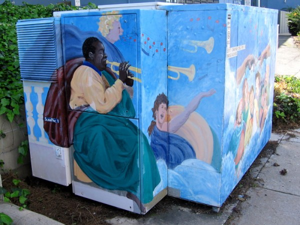 Louis Armstrong plays his trumpet in heaven with an angel nearby. Some colorful street art painted on a large electrical box on Camino del Rio South in Mission Valley.