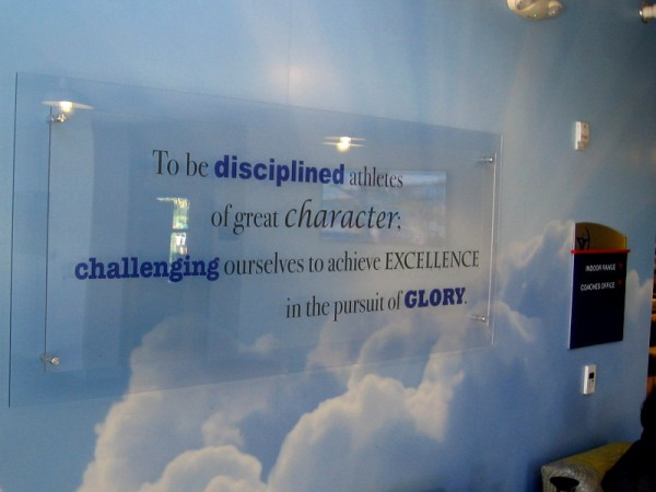 Words inside the archery building at the Chula Vista Elite Athlete Training Center. To be disciplined athletes of great character; challenging ourselves to achieve excellence in the pursuit of glory.
