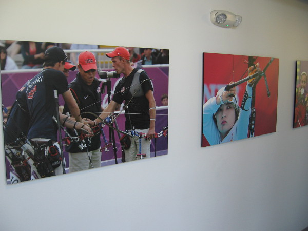 Photos on the wall inside the front door show Olympic archers together and in competition.