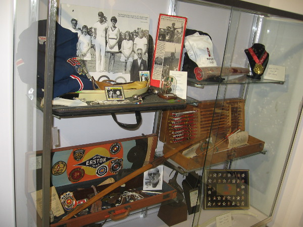 A display case shows artifacts relating to the history of organized archery and Easton bows and arrows.