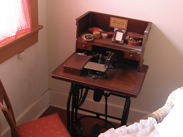 An old sewing machine can be found by a window upstairs.