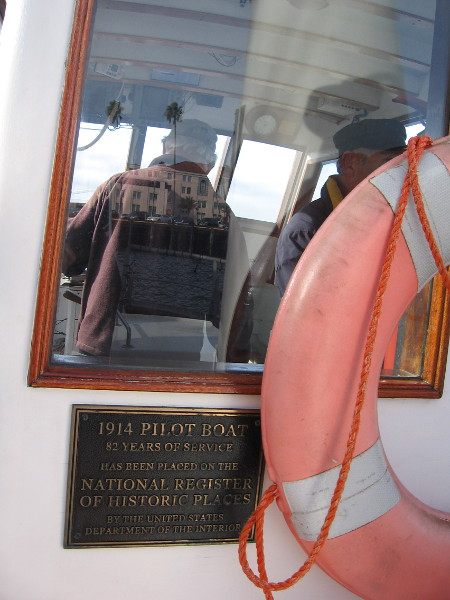 A plaque indicates the 1914 Pilot Boat has 82 years of service and has been placed on the National Register of Historic Places.
