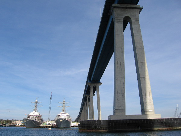 Under the bridge we go, looking east at two Navy ships.