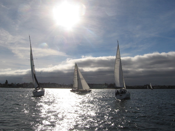 A magical look west toward sails, clouds and the descending sun.