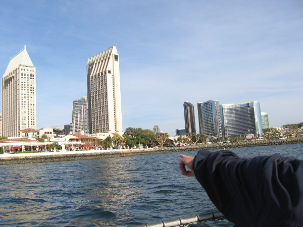 Our tour guide points toward Seaport Village. I see the silvery Marriott Marquis to the right.