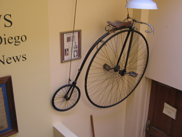 An old-fashioned penny-farthing bicycle reminds visitors to the William Heath Davis House Museum of what life was like a century and a half ago in San Diego.