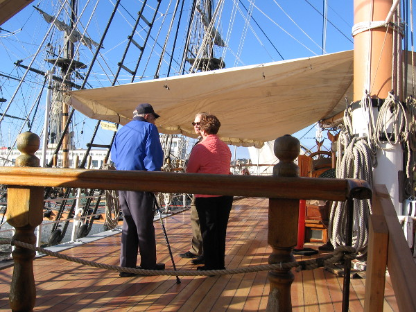 Folks enjoy a sunny San Diego day on the newly restored poop deck of the historic tall ship Star of India.