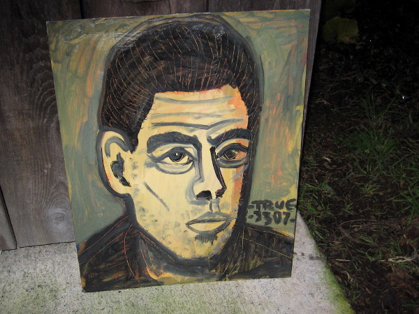 Cool painting of male face found leaning up against a dumpster enclosure on Cortez Hill.