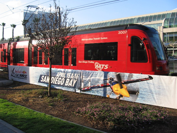San Diego Trolley leaves the Gaslamp Station and passes a new banner advertising the Red Bull Air Race in mid-April.