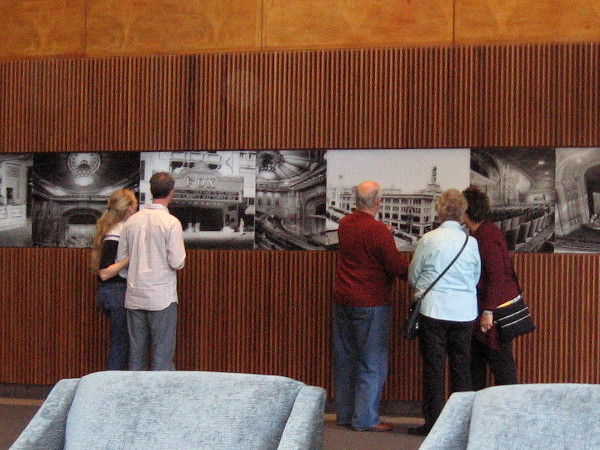 Visitors check out historical photos of the Fox Theatre movie palace on a wall near the San Diego Symphony box office.