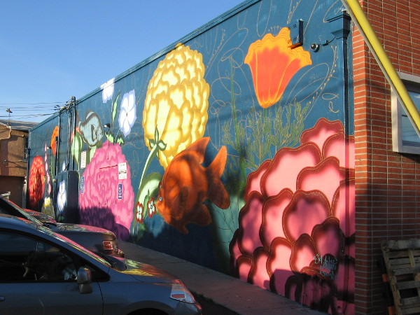 A beautiful mural in Hillcrest behind Artist and Craftsman Supply depicts flowers and sea life.