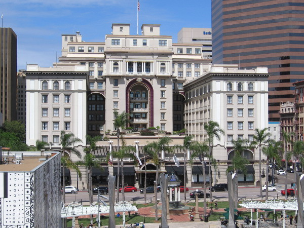 The south side of the historic U.S. Grant Hotel, as seen from an upper level of Horton Plaza. The 1910 Broadway Fountain is visible in Horton Plaza Park.