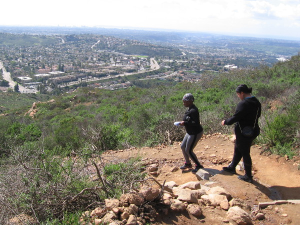 Hikers descend from the summit of Cowles Mountain, which rises above San Diego's San Carlos neighborhood.