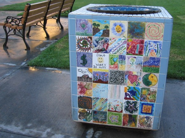 Lots of colorful tile art with happy environmental themes decorates this trash can in downtown San Diego's Pantoja Park.