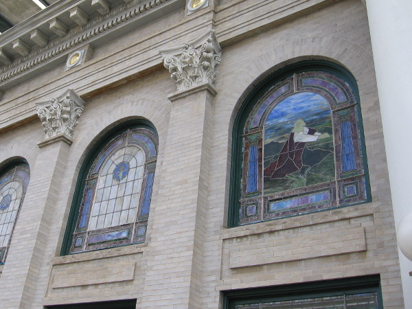 Stained glass windows seen from the outside.
