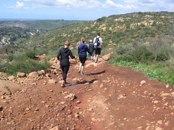 A group hikes up the trail.