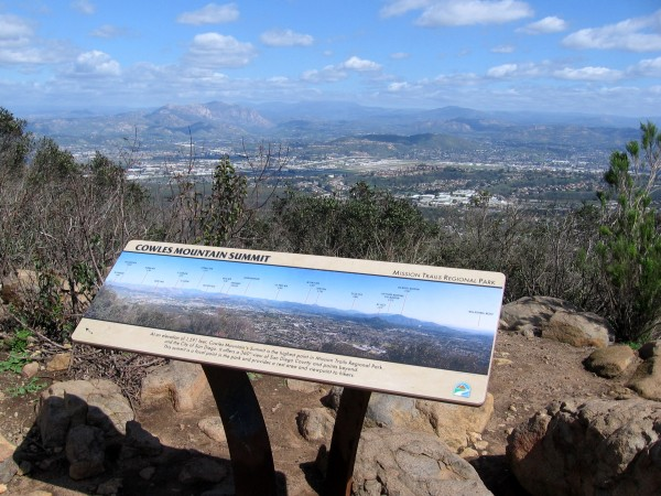 A second sign shows mountains from the north to southeast, including Mt. Woodson, San Jacinto, Palomar Mountain, Cuyamaca Peak, the Laguna Mountains, Otay Mountain and San Miguel Mountain.