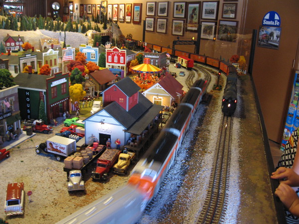 The huge train layout has two halves--one represents daytime, the other night. Kids can stand on platforms to see--and hear--all the action.