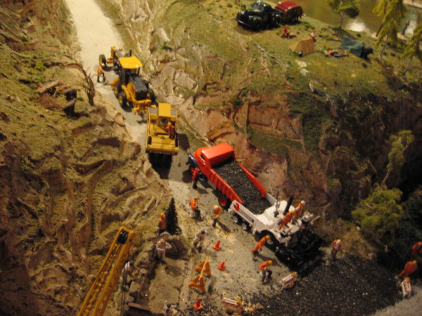 Tiny human figures and vehicles can be spotted everywhere one looks on the realistic layout.
