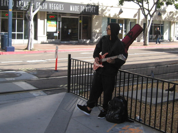 A street musician near the C Street trolley tracks.