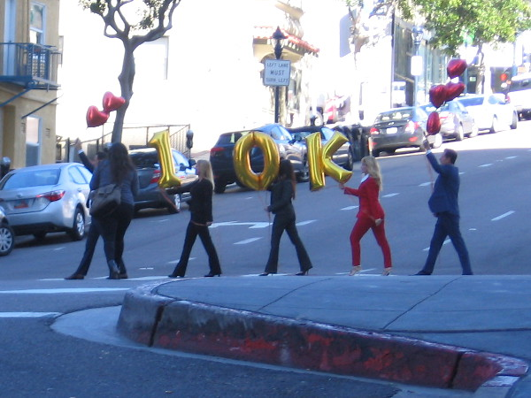 Finally, I spotted these people as I headed back up Cortez Hill. They were crossing the street with some shining balloons. I guess it must be someone's anniversary!
