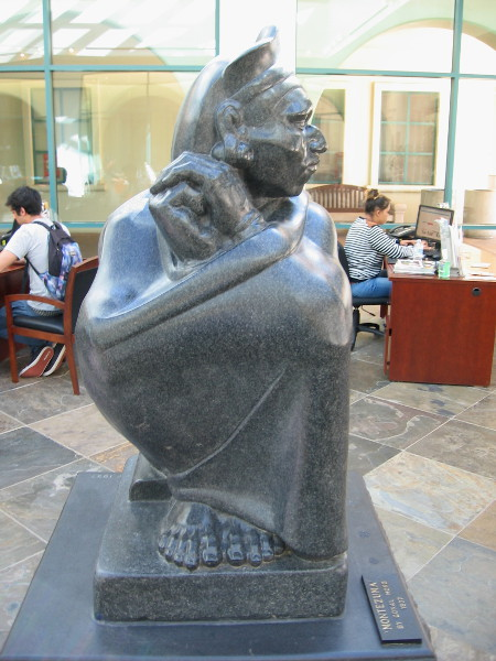 Side view of the Aztec shows gracefully folded hands and strongly planted feet.