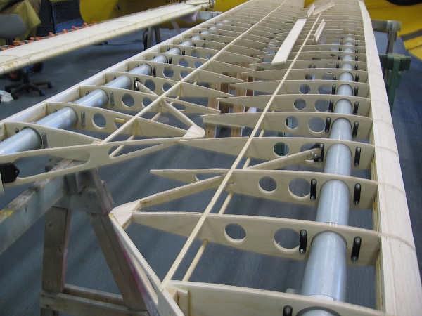A closer look at the spruce plywood ribs, which are spaced on the tubular steel spar.