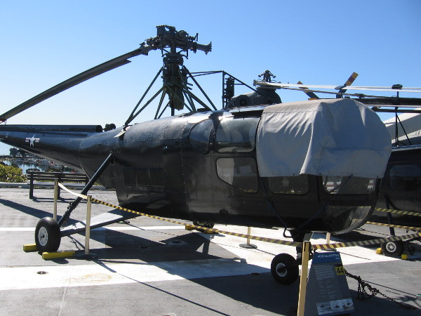 Here's the HO3S-1 Dragonfly helicopter up on the flight deck of USS Midway. Notice three of four rotors are missing.