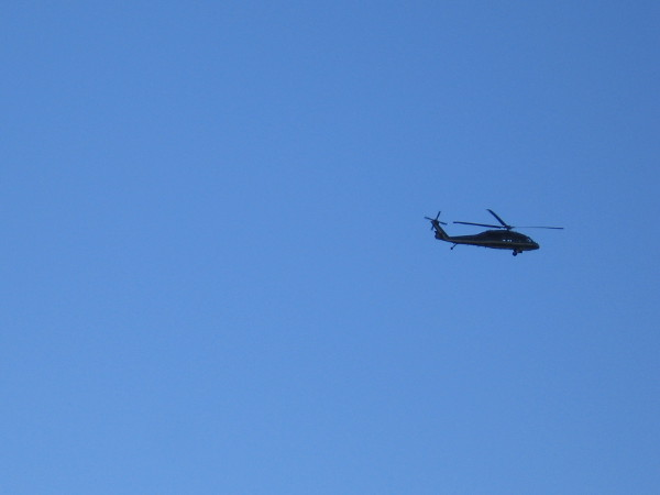 A helicopter passes overhead. A frequent sight near three large Navy bases on San Diego Bay: Naval Base San Diego, Naval Air Station North Island and Naval Base Point Loma.