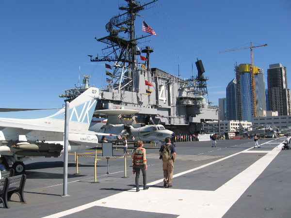 A look from the bow of the USS Midway back toward the carrier's Island superstructure and downtown San Diego skyscrapers.