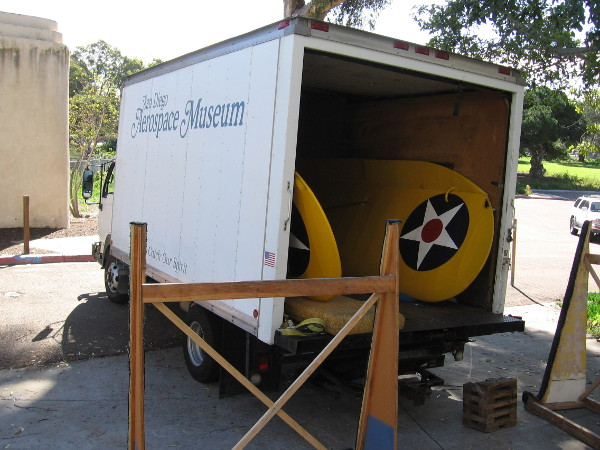 These yellow wings in the San Diego Air and Space Museum truck are heading to Gillespie Field in East County. They are part of a PT-22 airplane.
