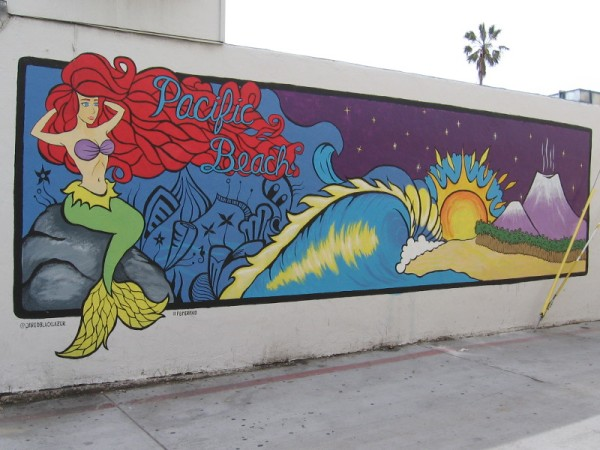 The Pacific Beach Mermaid hangs out on a colorful wall. Art by Jared Blake Lazar a.k.a Jared Black Lazer.