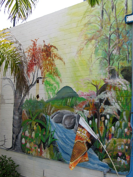 A tropical scene on a wall.