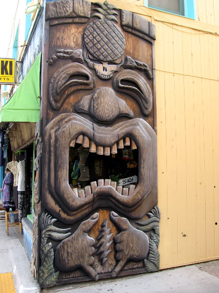 A wacky tiki character on a corner of a Mission Beach shop.