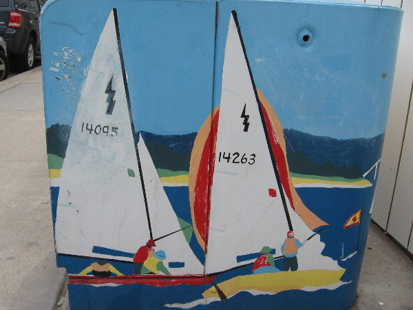 Two sailboats painted on an electrical box.