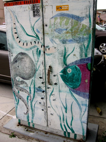 Another underwater scene on a utility box, faded by the sun.