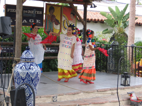 Traditional Mexican dance includes colorful dresses and big smiles.