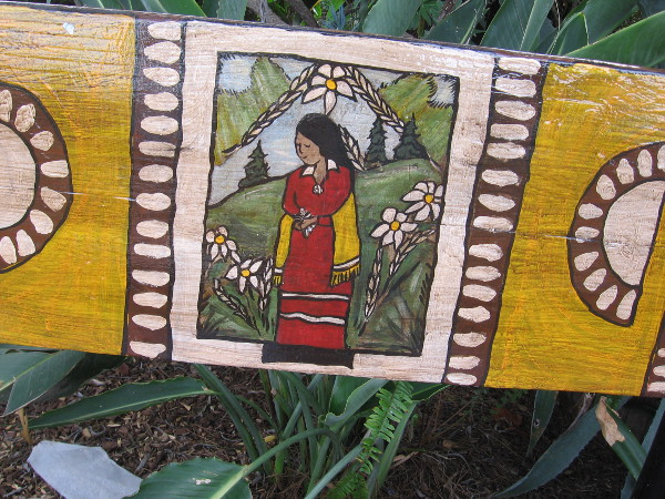Benches facing the stage include bits of cheerful folk art.