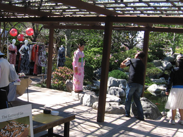 Many people gravitate toward the covered patio near the koi pond.