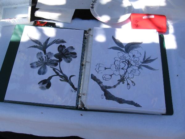 Some ladies at one table were demonstrating Japanese brush painting. A special exhibition in Balboa Park's Casa del Prado will take place March 25 and 26.