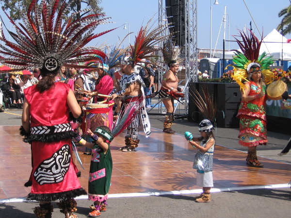 Dancers of all ages participate in several ancient Aztec dances, including a Rain Dance.