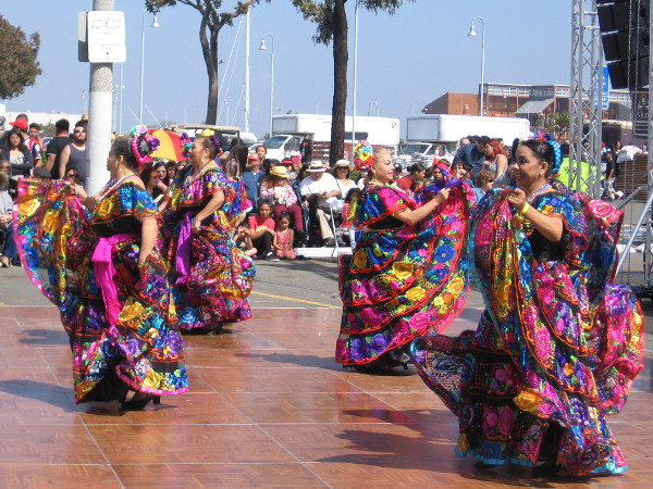 Smiles and brightly colorful dresses are both big parts of Mexican culture.