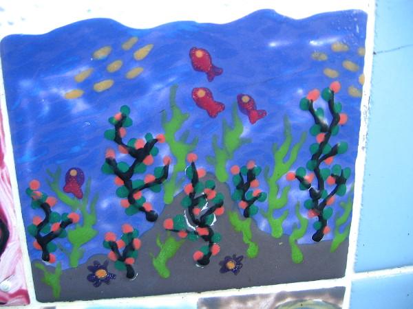 Fish enjoy a clean blue ocean.