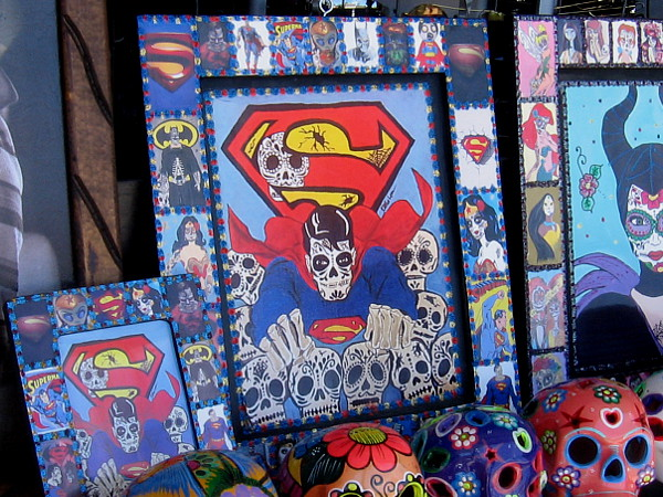 A skeletal Superman flying through skulls.