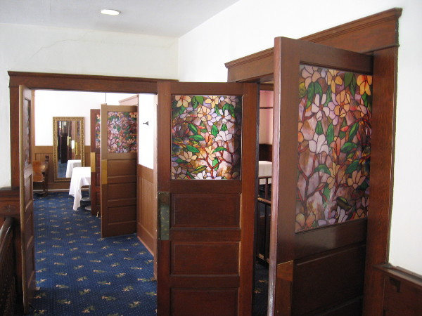 These doors on the second floor have beautiful floral stained glass panels.