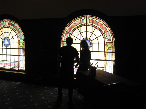 People pause by one of the south-facing stained glass windows.