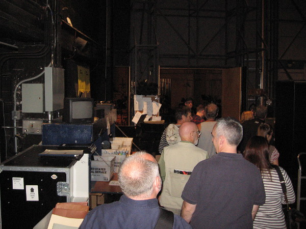 Behind the scenes! All sorts of interesting equipment could be glimpsed in the darkness behind the stage.