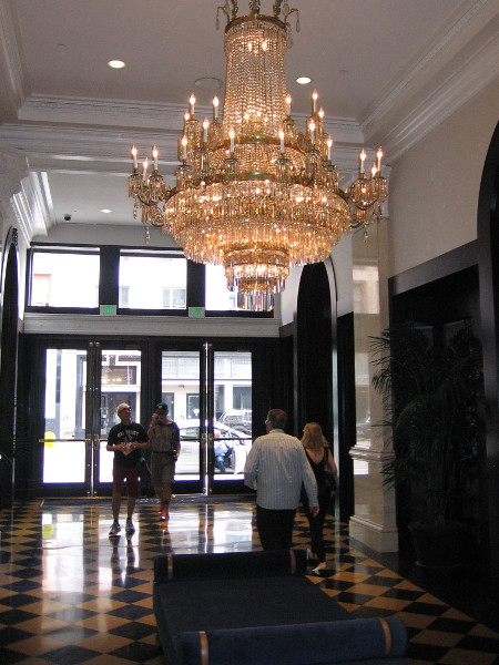 Large glittering chandeliers add a glamorous touch throughout the posh hotel.