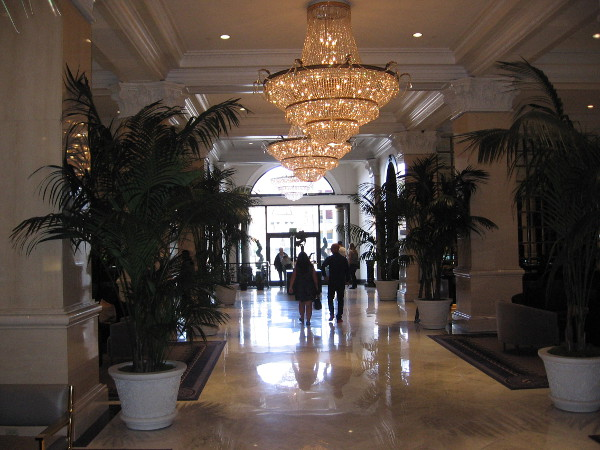 Standing in the grand lobby, looking south toward the U.S. Grant Hotel's entrance on Broadway.